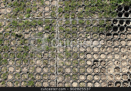 Safety mats on playground stock photo, Background of rubber safety mats on sandy surface with grass. by Martin Crowdy