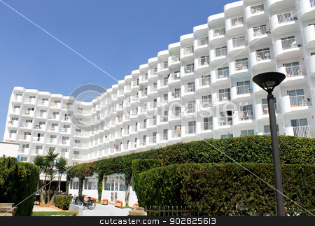 Tourist hotel on island of Majorca stock photo, Scenic view of large white tourist hotel on island of Majorca, Spain. by Martin Crowdy
