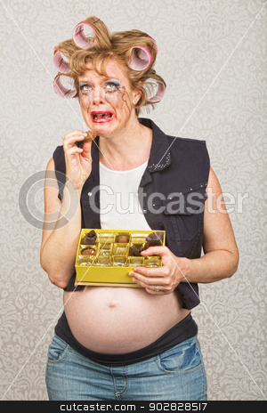Depressed Pregnant Woman stock photo, Depressed pregnant hick eating from box of chocolates by Scott Griessel