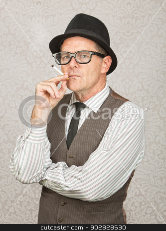 Skeptical Man Smoking stock photo, Skeptical white businessman with hat smoking a cigarette by Scott Griessel