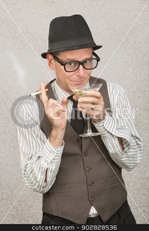 Smirking Man Sipping Martini stock photo, Smirking businessman with hat and eyeglasses drinking alcohol by Scott Griessel