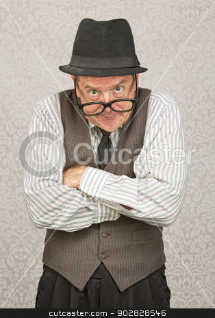 Businessman Scoffing stock photo, Single mad businessman with hat and folded arms by Scott Griessel