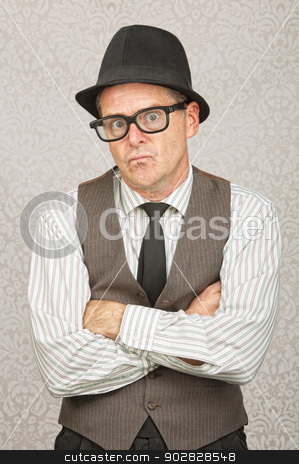 Irritated Businessman stock photo, Frustrated businessman in fedora with folded arms by Scott Griessel