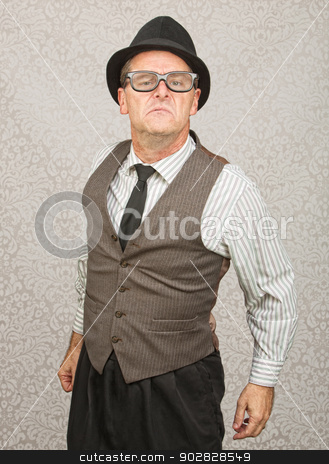 Bragging Man in Eyeglasses stock photo, Bragging single businessman with hat and eyeglasses by Scott Griessel