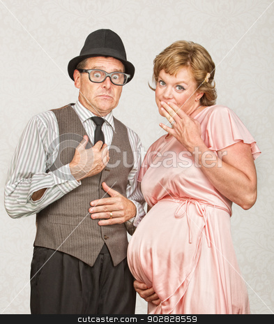 Coy Pregnant Couple stock photo, Embarrassed European male next to pregnant woman by Scott Griessel