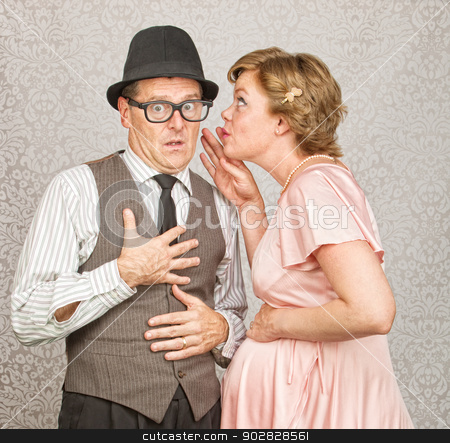 Pregnant Woman Whispering to Man stock photo, Cute pregnant woman whispering to nervous man by Scott Griessel