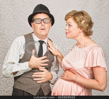 Father with Pregnant Woman stock photo, Surprised man being told he is a father by pregnant woman by Scott Griessel