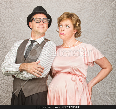 Man with Bored Pregnant Woman stock photo, Proud 1950s man with bored pregnant woman by Scott Griessel