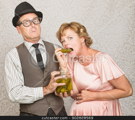 Man with Craving Pregnant Woman stock photo, Craving pregnant woman eating pickles from a jar by Scott Griessel