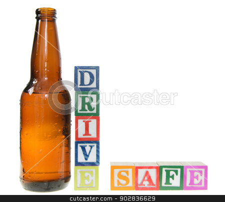 Letter blocks spelling drive safe with a beer bottle stock photo, Letter blocks spelling drive safe with a beer bottle. Isolated on a white background by Richard Nelson