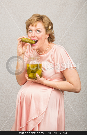 Expecting Woman with Pickle stock photo, Overjoyed pregnant female eating from a jar of pickles by Scott Griessel