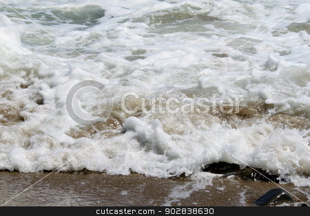 White Water stock photo, White water hitting the beach with small waves. by Henrik Lehnerer