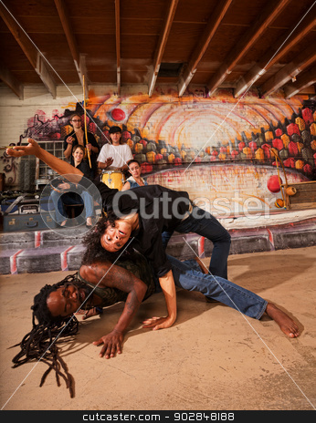 Capoeira Performers Twisting stock photo, Hispanic capoeira experts bending and twisting their bodies by Scott Griessel