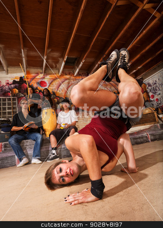 Female Capoeira Performer Posing stock photo, Female capoeira performer posing on floor indoors by Scott Griessel