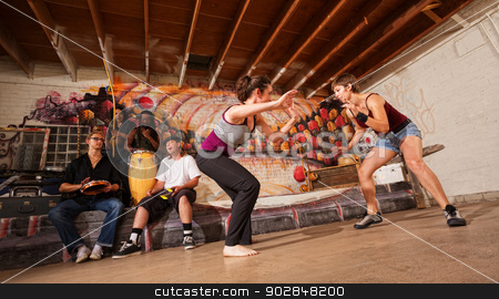 Female Capoeira Martial Artists stock photo, Female capoeira martial artists and musicians performing indoors by Scott Griessel