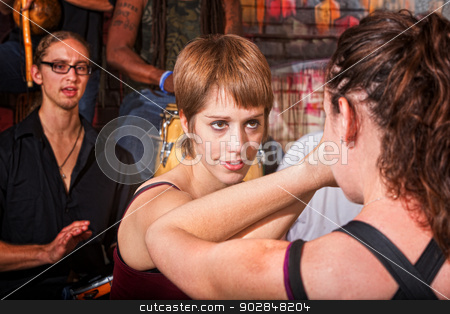 Confident Sparring Partner stock photo, Confident woman sparring with partner in martial arts by Scott Griessel