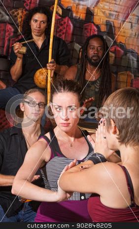 Serious Capoeira Woman Blocking stock photo, Serious capoeira blocking an attack with partner by Scott Griessel