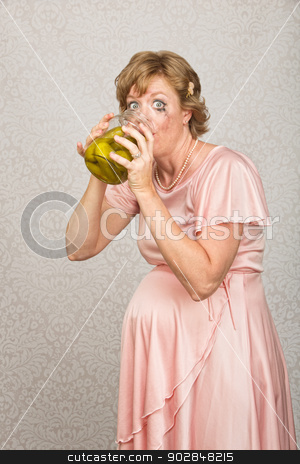 Thirsty Pregnant Woman stock photo, Ashamed pregnant woman drinking vinegar from pickle jar by Scott Griessel