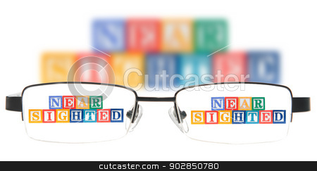 Letter blocks spelling near sighted with a pair of glasses. stock photo, Letter blocks spelling near sighted with a pair of glasses. Isolated on a white background. by Richard Nelson