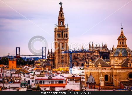 Giralda Bell Tower Cathedral of Saint Mary of the See Spire Chur stock photo, Giralda Spire Bell Tower Seville Cathedra, Cathedral of Saint Mary of the See Church of El Salvador Seville, Andalusia Spain.  Giralda is largest Gothic Cathedral in the World and burial Place of Christopher Columbus.   by William Perry