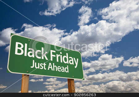Black Friday Just Ahead Green Road Sign and Clouds stock photo, Black Friday Just Ahead Green Road Sign with Dramatic Clouds and Sky. by Andy Dean