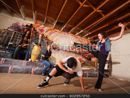 Man Dodging a Kick stock photo, Man dodging a woman kicking during a capoeira performance by Scott Griessel