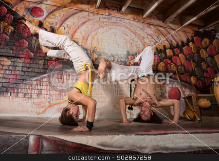 Mixed Capoeira Experts stock photo, Two mixed capoeira performers in urban building upside down by Scott Griessel