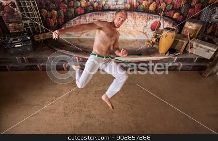 Capoeira Twisting Kick stock photo, Caucasian capoeira performers jumping for a twisting kick by Scott Griessel
