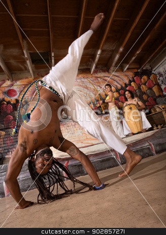 Capoeira Cartwheel stock photo, Capoeira man performing a cartwheel flip indoors by Scott Griessel