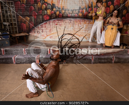 Group of Capoeira Performers stock photo, Group of capoeira performers in action and playing music by Scott Griessel