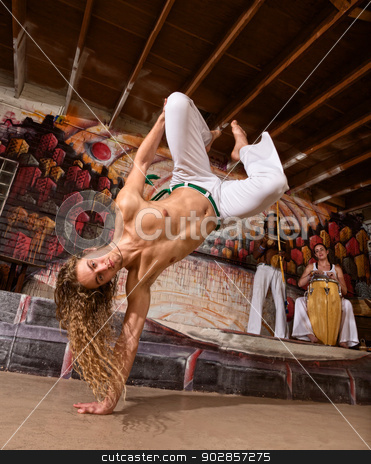Man Leaping on One Hand stock photo, Handsome capoeira performers leaping on to one hand by Scott Griessel