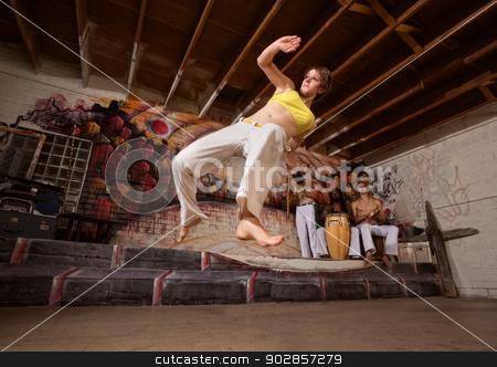Flexible Capoeira Woman stock photo, Flexible woman performing a capoeira jumping kick by Scott Griessel