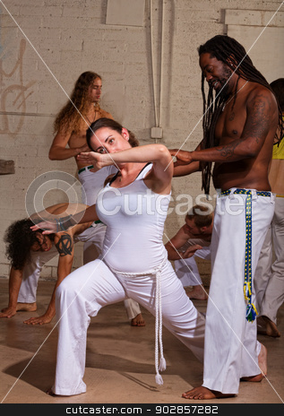 Smiling Capoeira Teacher stock photo, Smiling capoeira teacher working with female student by Scott Griessel