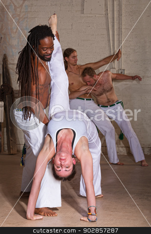 Capoeira Holding Student Backward stock photo, Capoeira instructor holding student that is bending backwards by Scott Griessel