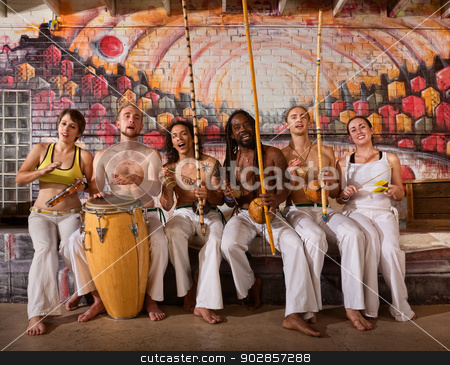 Cheerful Capoeira Team Singing stock photo, Group of six capoeira performers playing instruments and singing by Scott Griessel