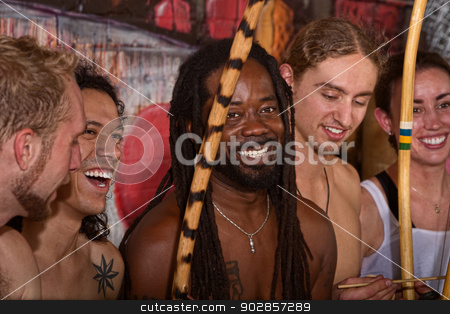 Happy Capoeira Group stock photo, Handsome Brazilian man with group of capoeira performers by Scott Griessel