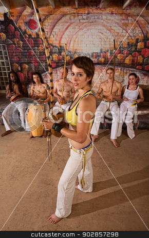 Capoeira Berimbau Musician with Friends stock photo, Caucasian capoeira performers holding berimbau with group by Scott Griessel