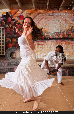 African Drummer and Woman stock photo, Pretty woman dancing and handsome pandeiro drummer  by Scott Griessel