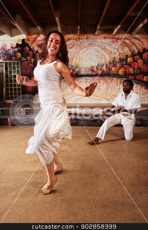 Drummer and Woman Performing stock photo, Brazillian dancer and pandeiro drummer performing indoors by Scott Griessel