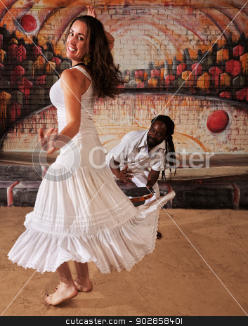 Cute Dancing Woman with Drummer stock photo, Happy dancing woman with handsome drummer indoors by Scott Griessel