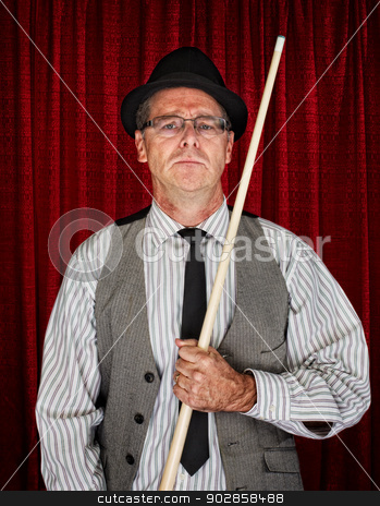 Pool Player in Pinstripe stock photo, Serious retro style man with pool cue on curtain background by Scott Griessel