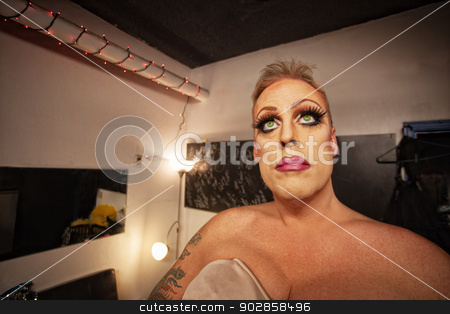 Man in Drag in Dressing Room stock photo, Serious male in drag waiting in dressing room by Scott Griessel