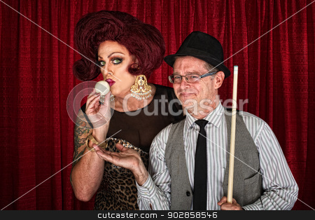 Drag Queen Kissing Cue Ball stock photo, Cross dressing man kissing cue ball with smiling friend by Scott Griessel