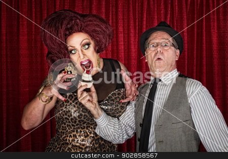 Hungry Drag Queen stock photo, Hungry drag queen and friend holding cupcake by Scott Griessel