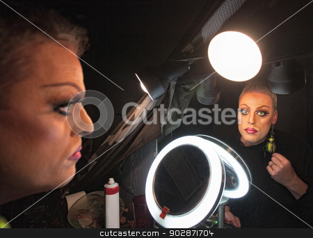 Serious Drag Queen stock photo, Serious drag queen in front of mirror with lamp by Scott Griessel