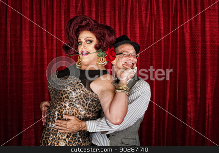 Happy Drag Queen with Partner stock photo, Happy man in drag with smiling businessman by Scott Griessel