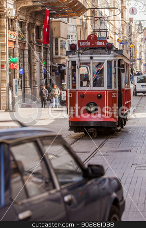 Istanbul Trolley stock photo, ISTANBUL, TURKEY – APRIL 28: Trolley car on busy street on April 28, 2012 in Istanbul, Turkey.  Each year patriotic Turks honor those fallen at the battle of Galipoli during World War I. by Scott Griessel