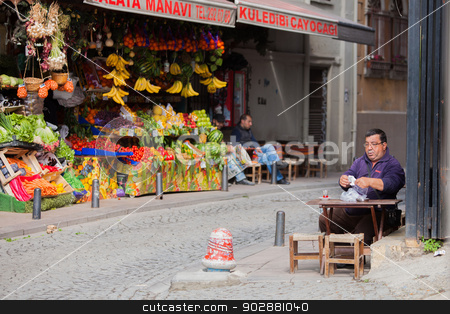 Drinking Apple Tea in Istanbul stock photo, Istanbul, TURKEY – APRIL 28: Man enjoys apple tea on a sidewalk on April 28 2012 in Istanbul, Turkey.  Each year patriotic Turks honor those fallen at the battle of Galipoli during World War I. by Scott Griessel