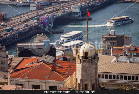 Water Traffic Near the Galata Bridge stock photo, ISTANBUL, TURKEY – APRIL 28: The New Mosque and neighboroods along the Bosphorus on April 28, 2012 in Istanbul, Turkey prior to Anzac Day.  The Bosphorus divides Turkey between Europe and Asia.   by Scott Griessel