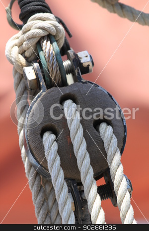 Block and Tackle stock photo, Block and tackle from a sail boat. by Henrik Lehnerer